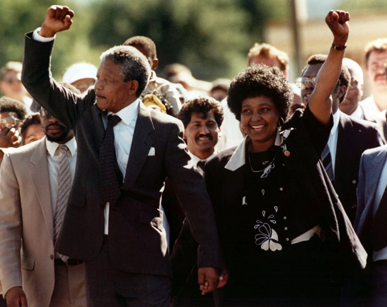 Nelson Mandela and wife Winnie, walking hand in hand, raise clenched fists upon his release from Victor prison, Cape Town, Sunday, February 11, 1990.  The African National Congress leader had served over 27 years in detention.