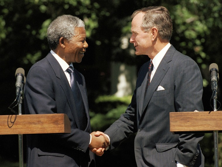 President George H. W. Bush shakes hands with South African national leader Nelson Mandela at the White House in Washington, June 25, 1990.