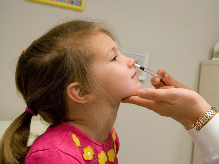 A child gets a FluMist influenza vaccine. CDC says vaccinations last year kept 79,000 people out of the hospital.