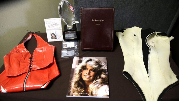 Items once owned by Farrah Fawcett, including a passport, scripts and her last driver's license were among memorabilia from the late actress put up for auction by her nephew.