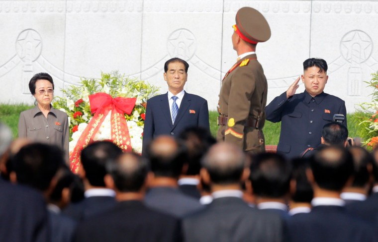 North Korean leader Kim Jong Un salutes as an honor guard marches past, while his aunt Kim Kyong Hui and Premier Pak Pong-ju watch during the opening ceremony of the Cemetery of Fallen Fighters of the Korean People's Army (KPA) in Pyongyang in this July 25, 2013.
