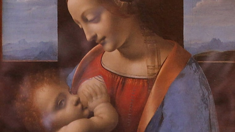 """ST. PETERSBURG, RUSSIA - JUNE 19: Visitors look at the painting """"Madonna and Child"""" by Leonardo da Vinci at the State Hermitage museum on June 19, 201..."""