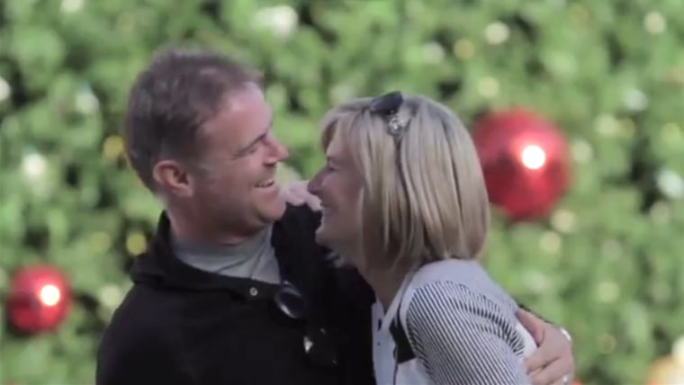 Couples of all ages have enjoyed a kiss under the flying mistletoe drone in San Francisco's Union Square.