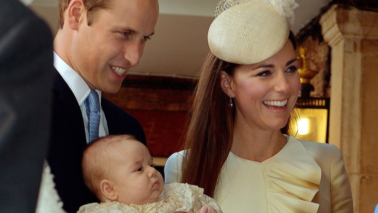 LONDON, ENGLAND - OCTOBER 23:  Prince William, Duke of Cambridge and Catherine, Duchess of Cambridge talk to Queen Elizabeth II (obscured) as they arr...