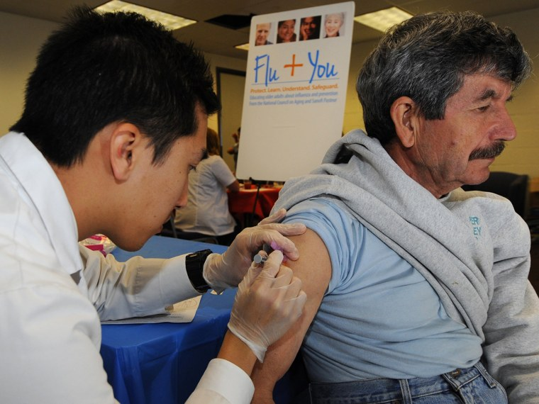 IMAGE DISTRIBUTED FOR NATIONAL COUNCIL ON AGING AND SANOFI PASTEUR - Pharmacist Jason To gives a flu shot to Joao Ferreira during the Flu + You event ...
