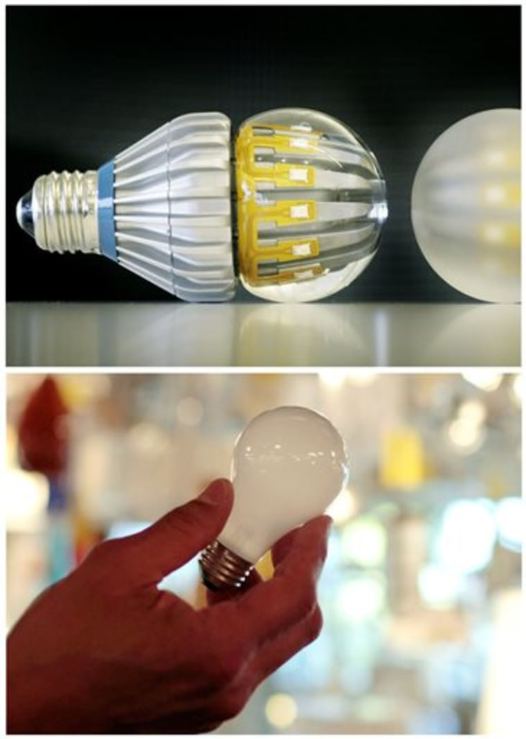 Home electricity use continues to fall, reaching levels last seen in 2001. This combination of Associated Press file photos shows, top, Switch75 light LED bulbs in clear and frosted, and a 100-watt incandescent light bulb at Royal Lighting in Los Angeles. LEDs use 70 percent to 80 percent less power than incandescent light bulbs.