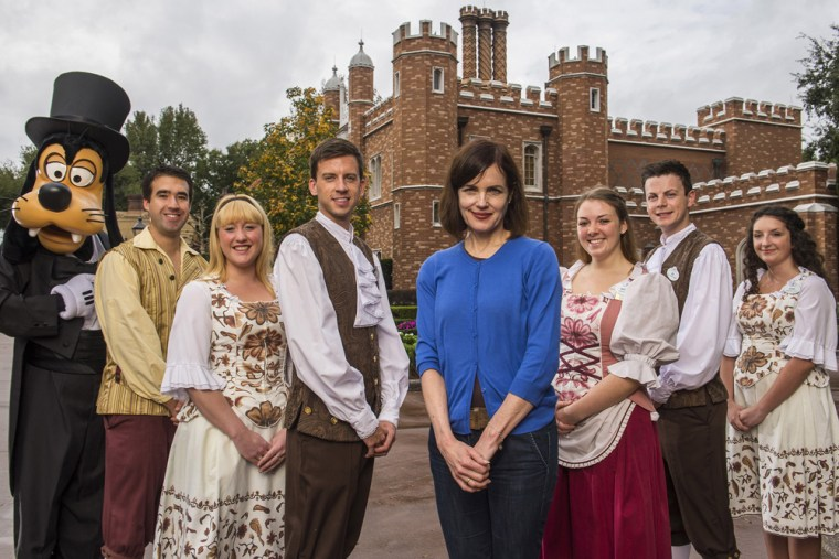 """Image: Elizabeth McGovern of """"Downton Abbey"""" poses with Goofy and Disney employees."""
