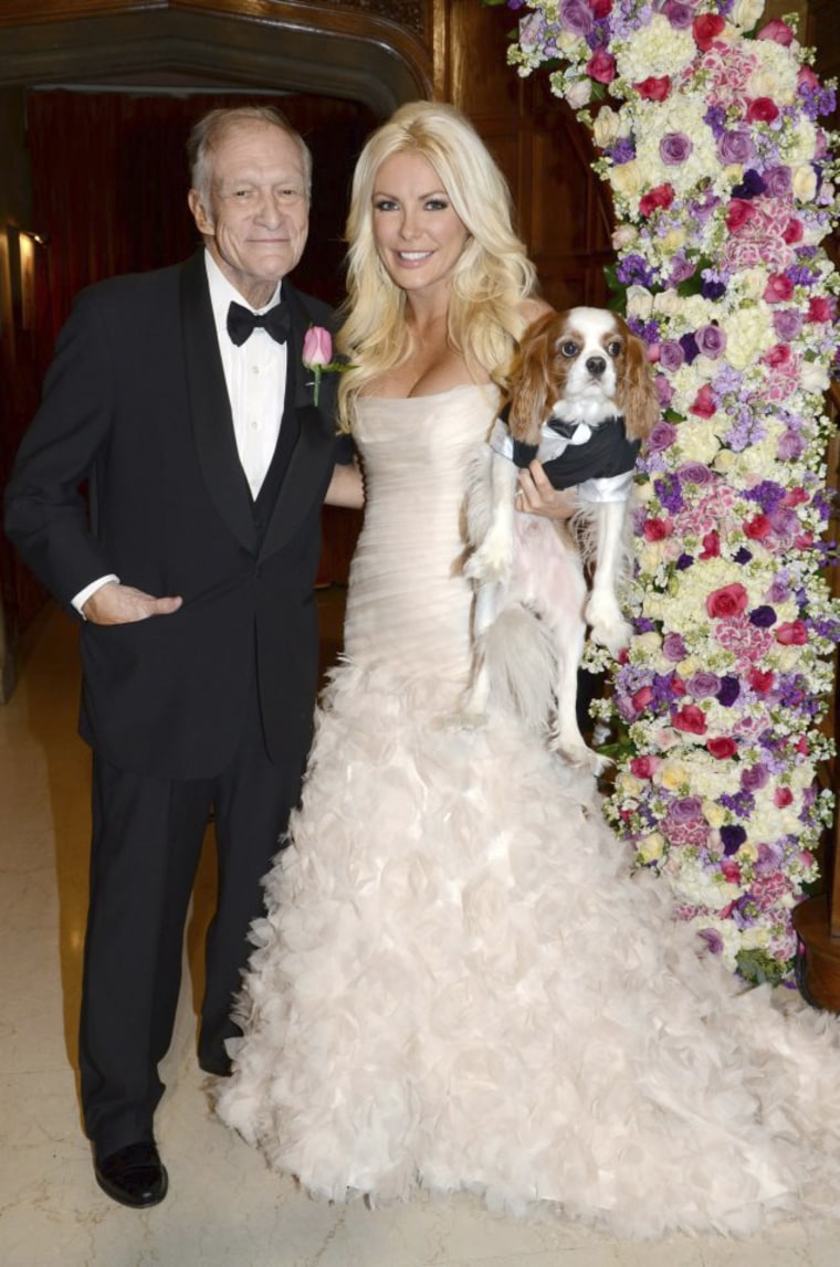 Hugh Hefner, Crystal Harris and dog Charlie.