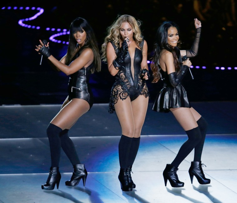 Beyonce performs with Kelly Rowland, left, and Michelle Williams, right, of Destiny's Child, during the Super Bowl halftime show.