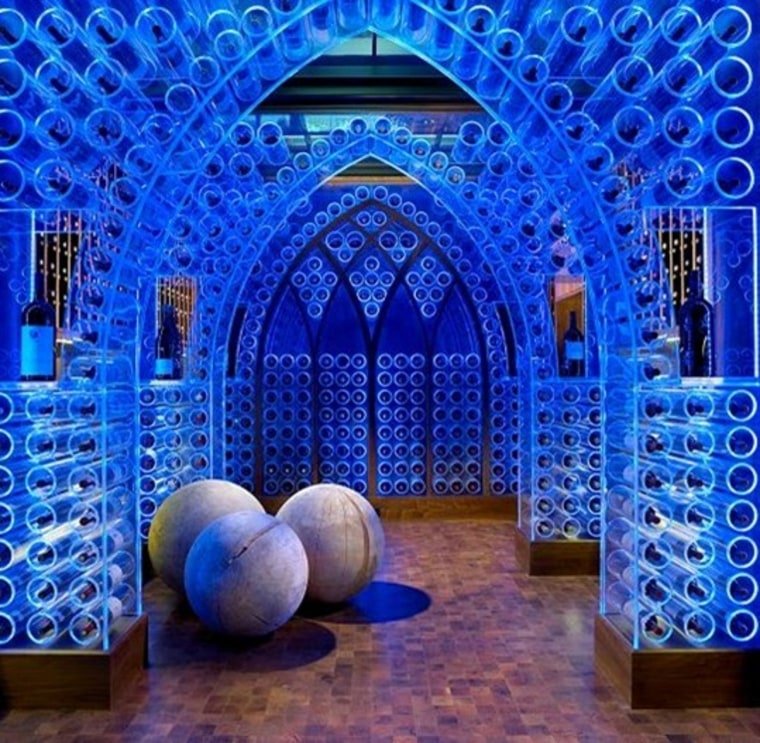 The wine cellar has lights that can be changed to different colors.