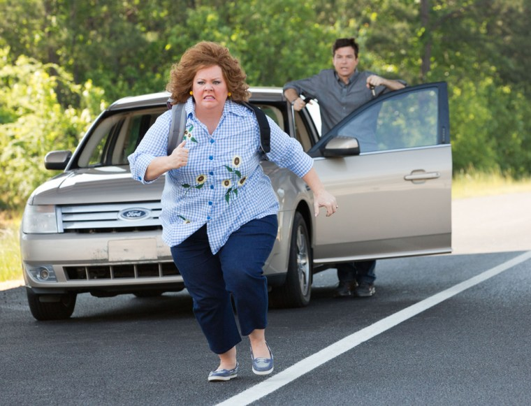 "Melissa McCarthy and Jason Bateman, background, in a scene from \""Identity Thief.\"""