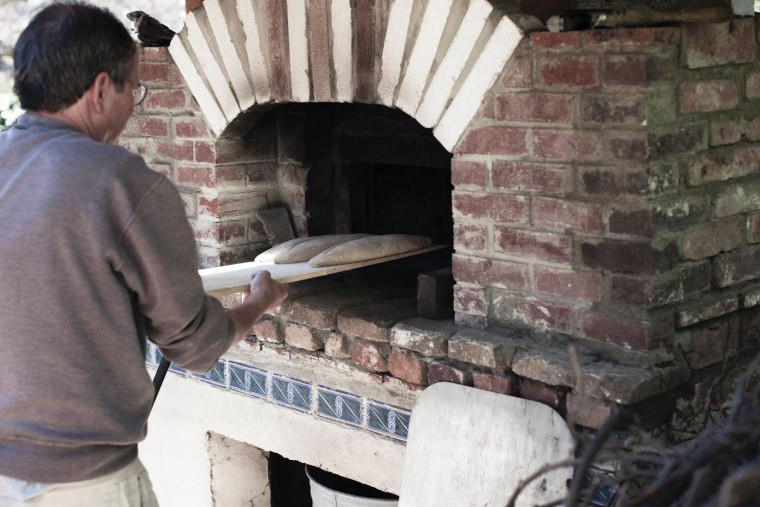 Stambler bakes bread in the stone oven he designed with his wife in their Los Angeles backyard.