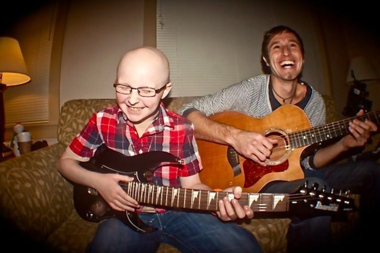 Braydon Hutchison, 11, and Melodic Caring Project founder Levi Ware jam at the Ronald McDonald House in Seattle. (Photo: Melodic Caring Project)