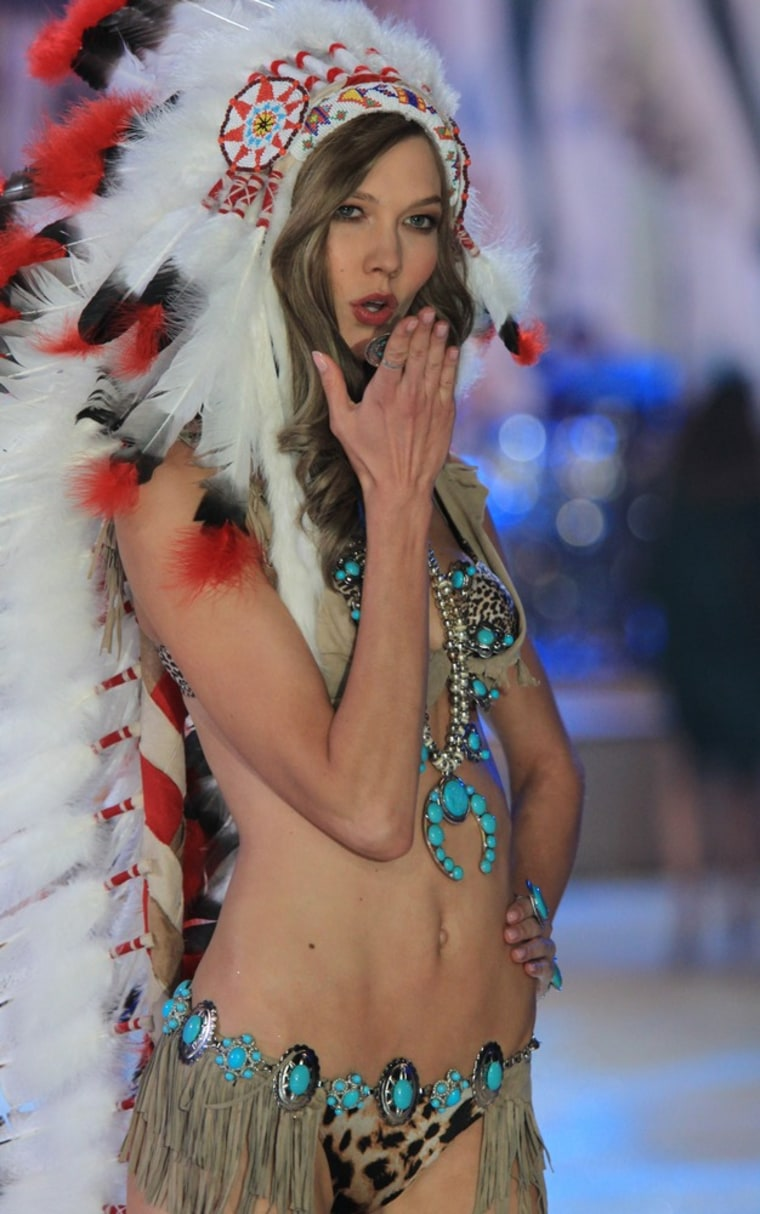 Model Karlie Kloss apologized for donning a Native American-inspired feather headdress along with turquoise accents.