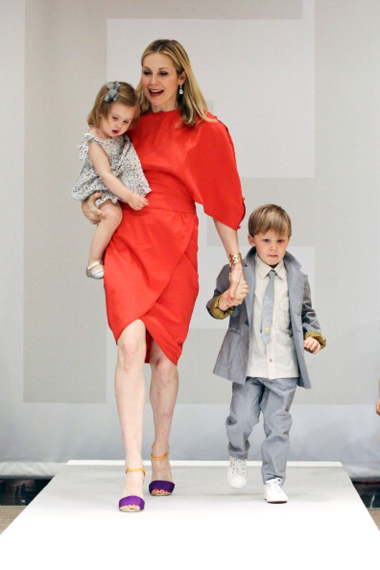 Holiday shopping? It's a family affair for Kelly Rutherford, shown here with son Hermes and daughter Helena at the Fendi Kid's SS11 Domestic Debit Fashion presentation on April 14 in New York City.