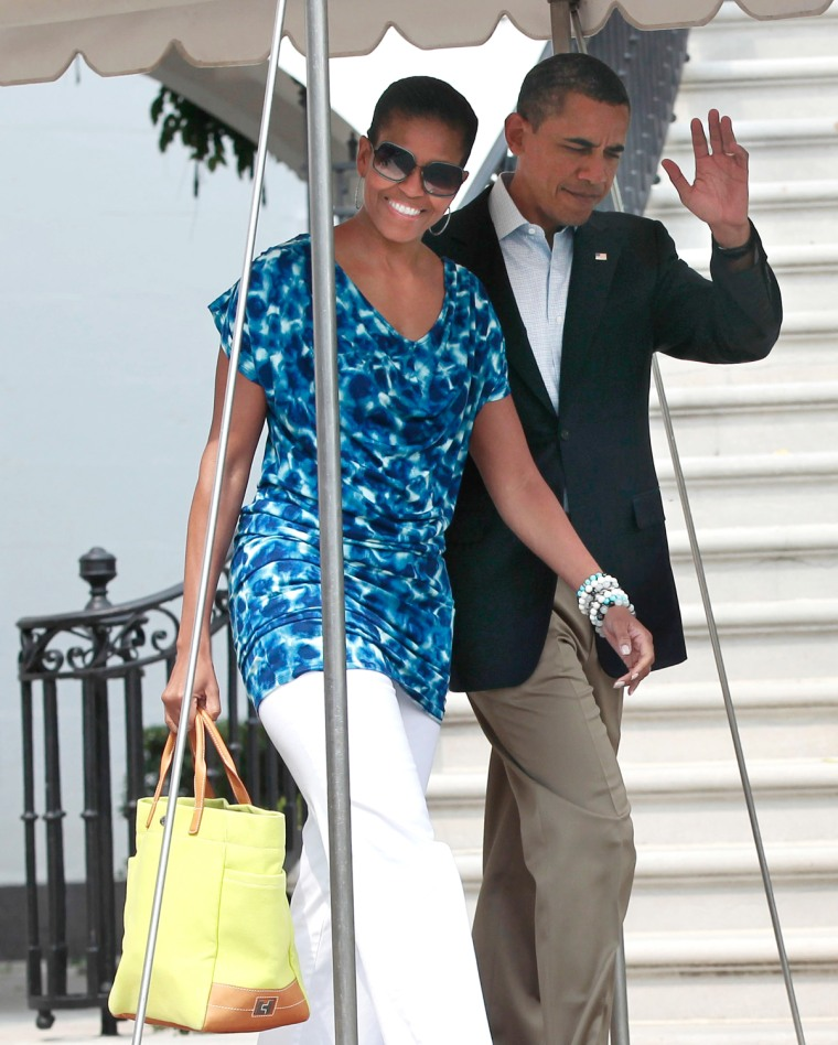 President Barack Obama and first lady Michelle Obama, in a $29 Gap dress, leave the White House on June 10.