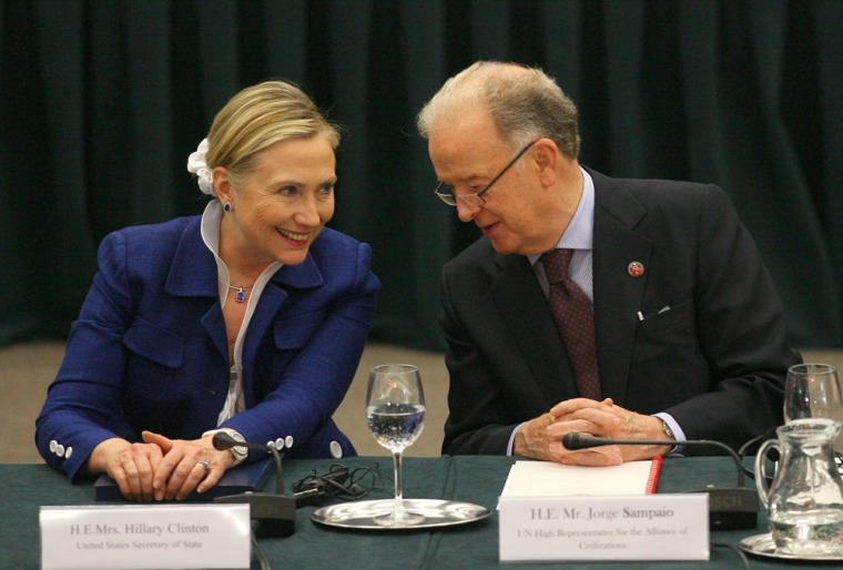 Hillary Clinton listens to Portugal's former president and UN High Representative Jorge Sampaio as they take part in the Community Of Democracies ministerial conference in Vilnius on July 1, 2011.