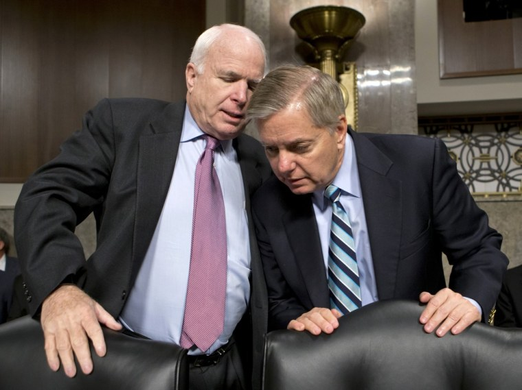 Senate Armed Services Committee members, Sen. John McCain, R-Ariz., left, and Sen. Lindsey Graham, R-S.C. confer on Capitol Hill, Thursday, Feb. 14, 2013, at the start of the committee's hearing on the appointments of military leaders.