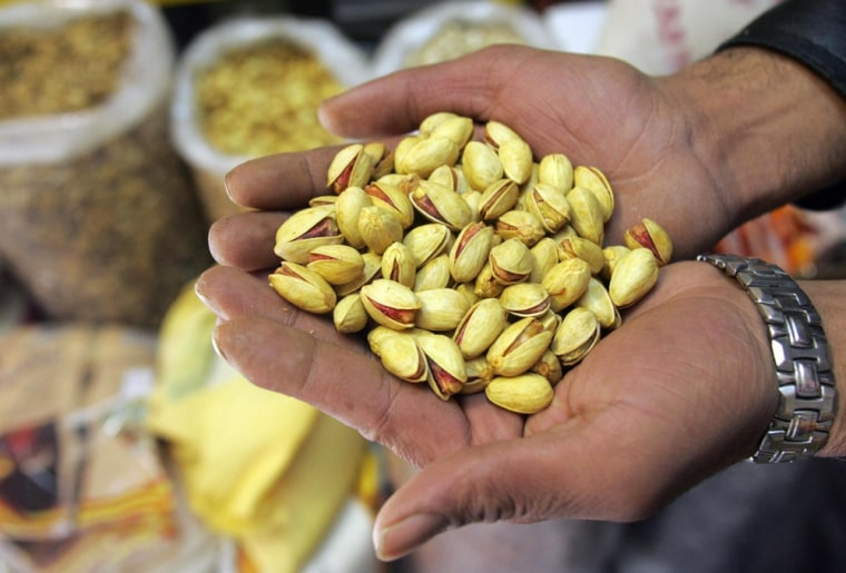 A pistachio wholesaler shows his goods at his shop in Tehran in November 2006.