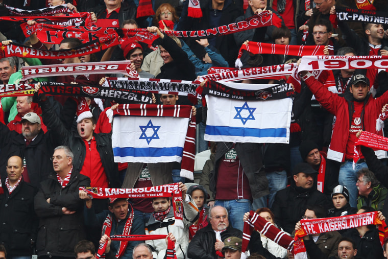Fans of the German soccer team Kaiserslautern hold up Israeli flags to protest against anti-Semitism prior to the Bundesliga match between FC Kaiserslautern and VfL Wolfsburg in March last year.
