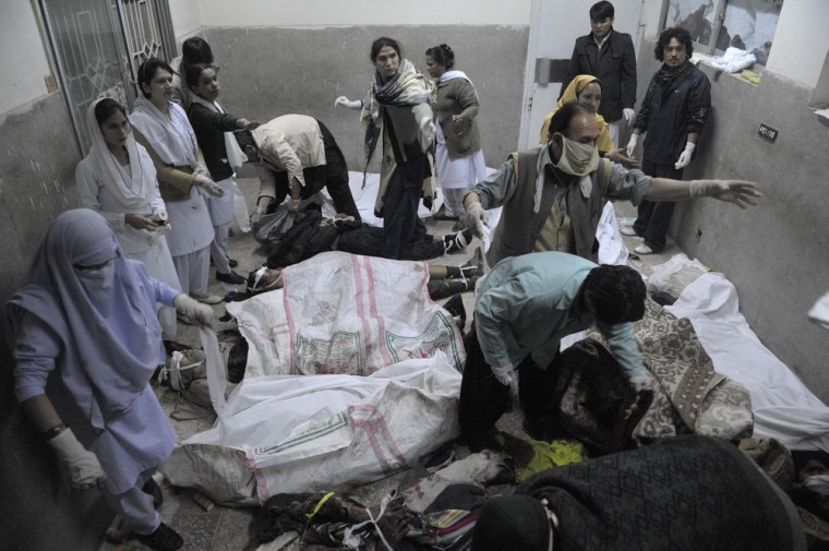 Pakistani paramedics work over the dead bodies of bomb blast victims at a hospital in Quetta on February 16, 2013. A remote-controlled bomb targeting Shiite Muslims killed 47 people including women and children and wounded more than 200 in Pakistan's insurgency-hit southwest on Saturday, police and officials said. AFP PHOTO/Banaras KHANBANARAS KHAN/AFP/Getty Images