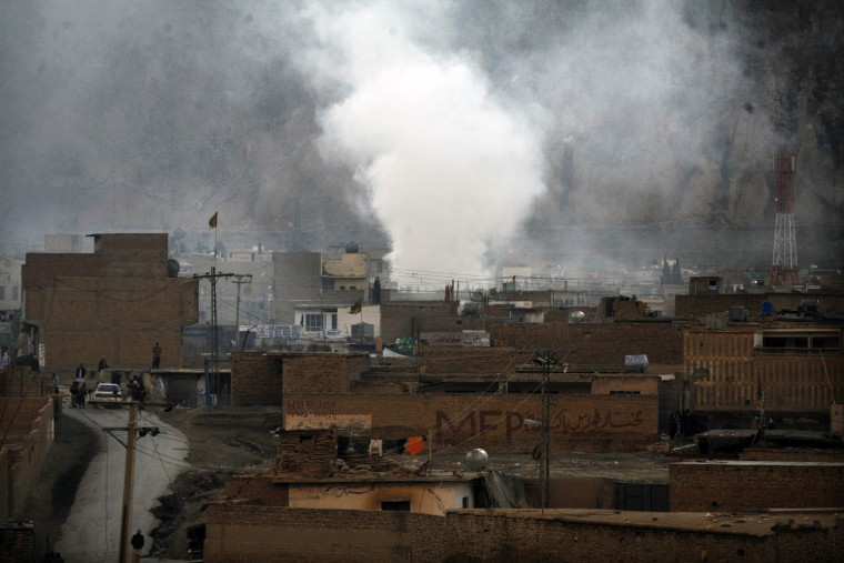 Smoke rises in a Shiite Muslim area after the attack Feb. 16.