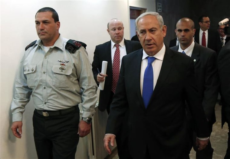 Israel's Prime Minister Benjamin Netanyahu (R) arrives at the weekly cabinet meeting in Jerusalem February 17, 2013. Netanyahu appealed on Sunday for Israel's secret services to be spared public scrutiny, in an apparent bid to douse speculation that an Australian immigrant's 2010 jailhouse suicide was espionage-related and covered up.