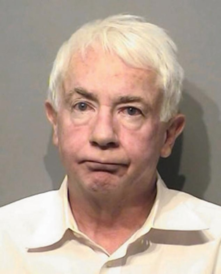 Joe Hundley was charged with assault after allegedly hitting a 19-month-old boy who had started to cry on a Delta flight.