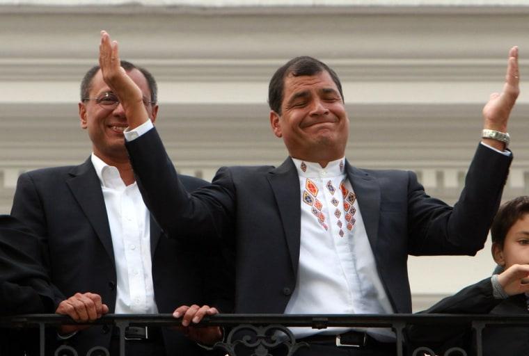 Ecuador's President Rafael Correa, right, and running mate Jorge Glass celebrate in Quito on Sunday.