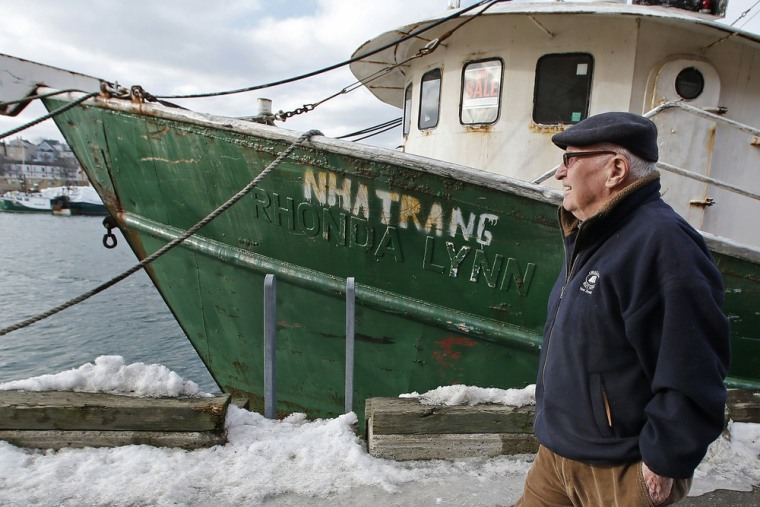 In this photo taken Wednesday, Feb. 13, 2013, Ron Gilson, a 79-year-old life Gloucester native, walks along the fish pier in Gloucester, Mass.