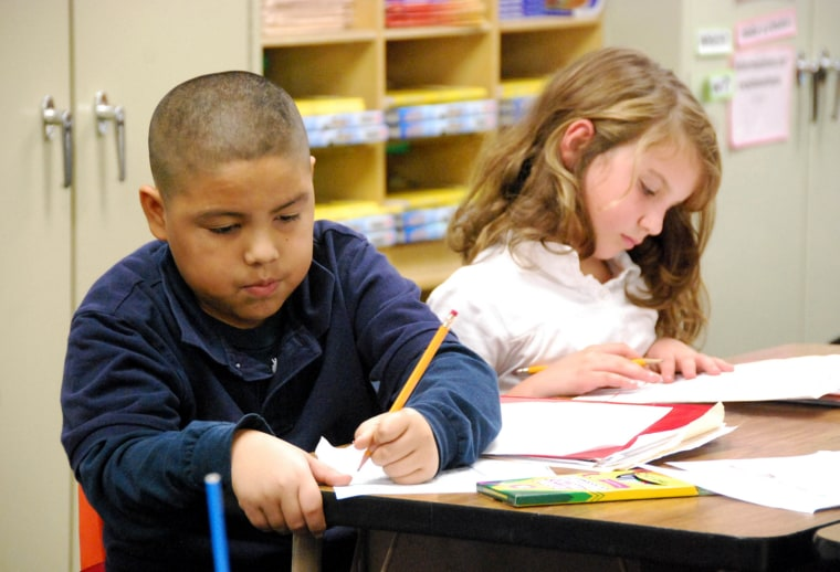 Third graders at Signal Hill Elementary work on a writing assignment.