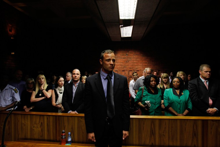 Oscar Pistorius awaits the start of court proceedings in the Pretoria Magistrates court on Feb. 19, 2013.