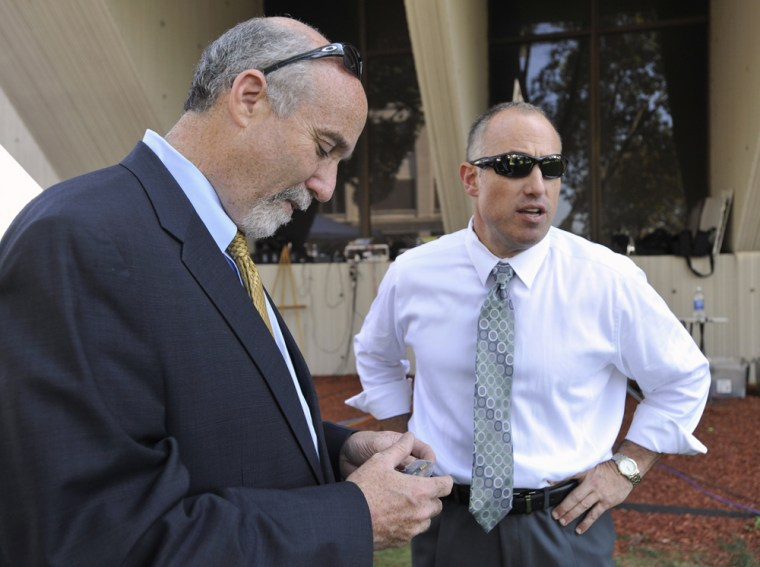 In this Sept. 6, 2012 file photo, Joel Brodsky, left, and Steven Greenberg, attorneys for former Bolingbrook, Ill., police officer Drew Peterson, confer outside the Will County Courthouse in Joliet, Ill., during the jury deliberations in Peterson's murder trial.