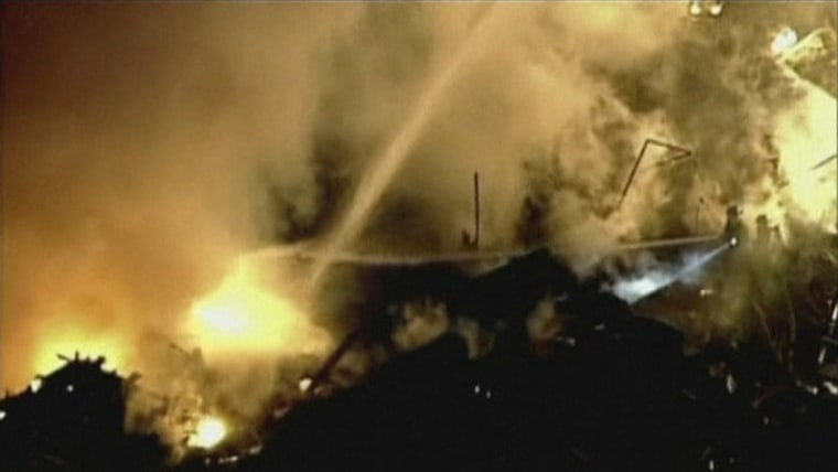 Firefighters working at the scene of a fire triggered by a natural gas explosion in Kansas City on Tuesday night.