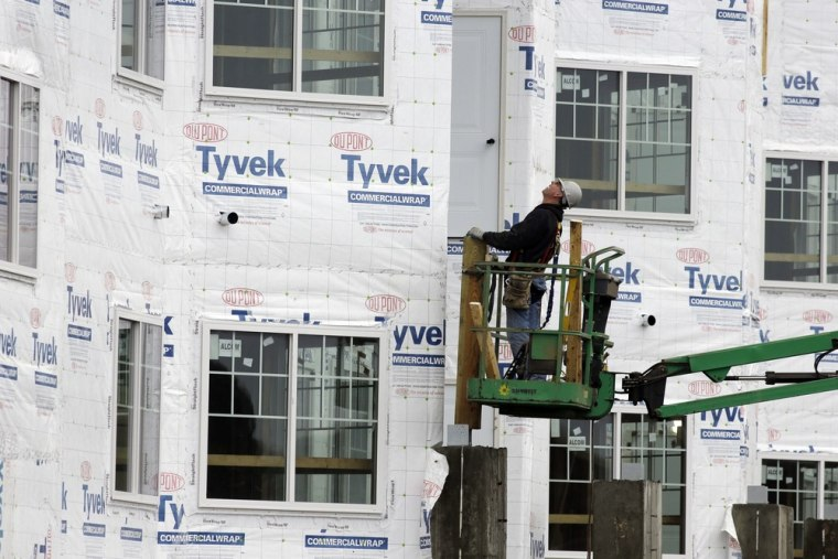 In this Friday, Jan. 11, 2013 photo, a construction worker works at a new home under construction in Chicago.