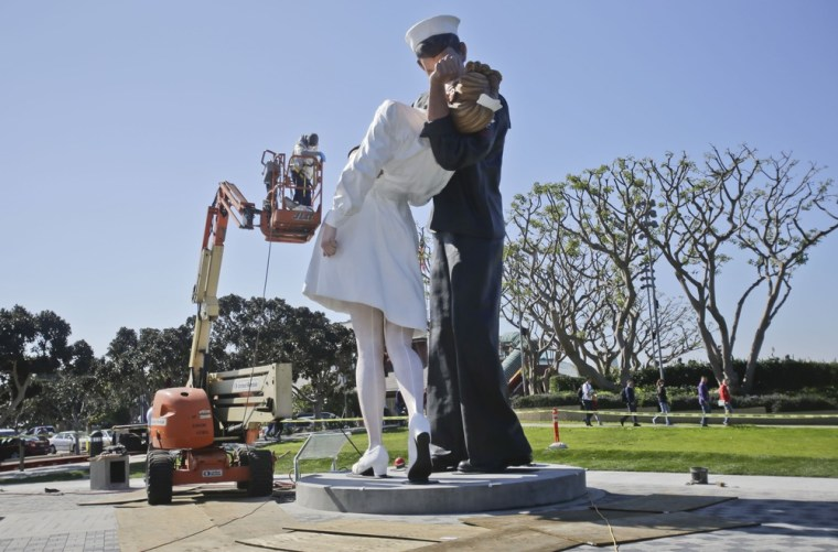 Finishing touches are made to the new kissing sailor statue on the embarcadero adjacent the USS Midway museum in San Diego. The statue, which was modeled after the renowned photograph by Alfred Eisenstaedt taken at the end of World War II, replaces a similar version that was moved out of San Diego last year.