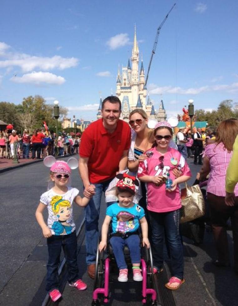 The family poses at Disney World