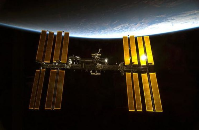 This image from a NASA space shuttle mission shows the International Space Station in orbit. The space station is the size of a football field and home to six astronauts.