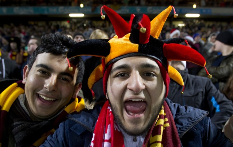 Bradford City supporters take to the stands before their fourth-tier team's win against English giants Arsenal on Dec. 11.