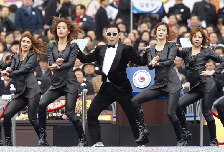 Singer Psy, center, performs during the inauguration of South Korea's President Park Geun-hye, not pictured, at parliament in Seoul on Feb. 25, 2013.