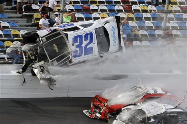 Kyle Larson (32) goes airborne and into the catch fence during a multi-car crash involving Justin Allgaier (31), Brian Scott (2) and others during the...