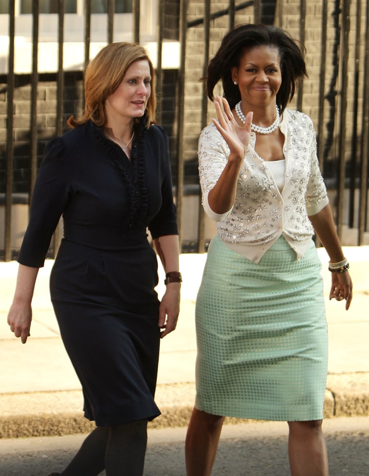 Sarah Brown, wife of Gordon Brown, walks with Michelle Obama from Downing Street on Apr. 1, 2009 in London, England. Michelle wore her mint green J.Crew skirt with yet another cute, sparkly sweater.