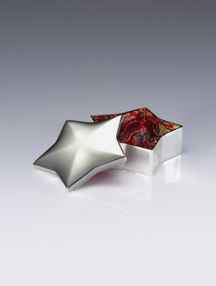 A brocade-lined, star-shaped, silver plated box that houses Shanghai Tang cufflinks