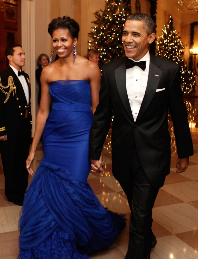 Talk about an entrance: President Barack Obama and first lady Michelle Obama arrive at the Kennedy Center Honors reception at the White House in Washington on Dec. 4, 2011.