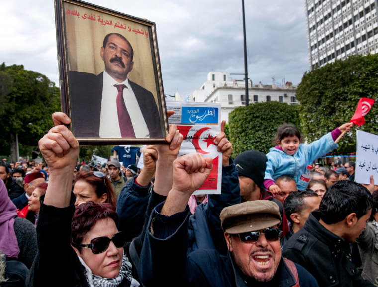 In a protest in Tunis on Saturday, hundreds of demonstrators demanded that the Islamist party in power find and arrest the killer of secular opposition politician Chokri Belaid.