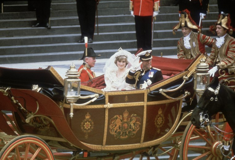 On July 29, 1981, Charles, Prince of Wales, and his wife, Princess Diana (1961 - 1997), wave to the crowds following their wedding ceremony at St Paul's Cathedral.