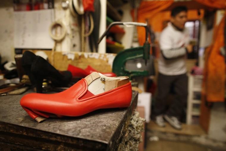 Shoemaker Antonio Arellano, whose customers include Pope Benedict XVI, in his shop in downtown Rome.