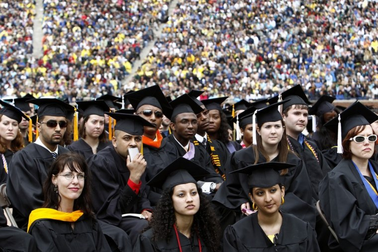 Graduating students at the University of Michigan commencement ceremony in Ann Arbor, Michigan in this May 1, 2010 file photograph. American families are failing to meet their college savings milestones as short-term needs and emergency savings take priority in family budgets.