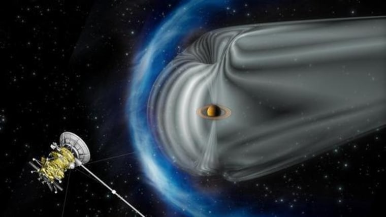 This artist's impression shows NASA's Cassini spacecraft exploring the magnetic environment of Saturn. Saturn's magnetosphere is depicted in gray, while the complex bow shock region — the shock wave in the solar wind that surrounds the magnetosphere — is in blue. The image is not to scale.