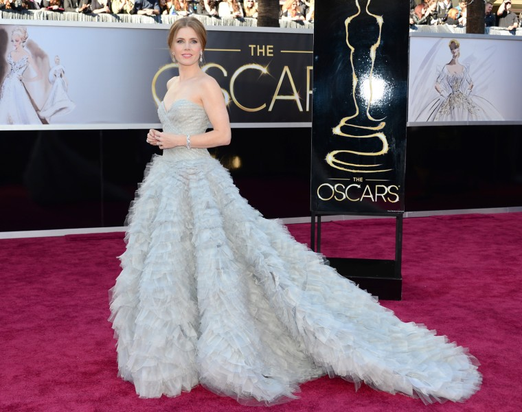 Best Supporting Actress nominee Amy Adams, wearing Oscar de la Renta, arrives on the red carpet for the 85th Annual Academy Awards on Feb. 24 in Hollywood, California.